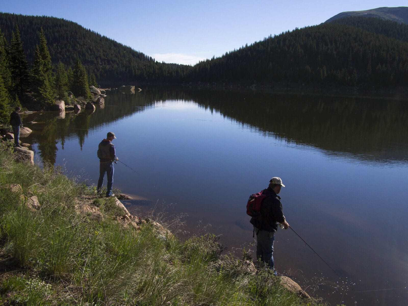 Image of two men fishing on the mason reservoir in pikes peak south slope recreation area