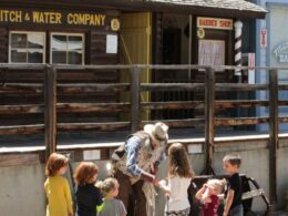 Image of a actor in the Pioneer Town Museum in Cedaredge teaching kids