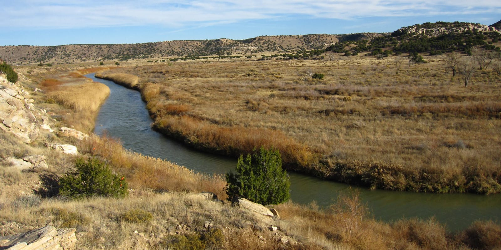 Image of the Purgatoire River flowing through the plains