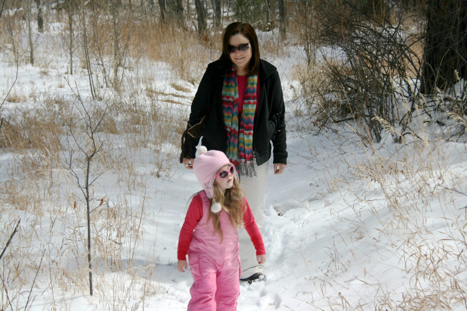 Image of a mom and daughter hiking in the snow at Reynolds Park in Conifer, Colorado