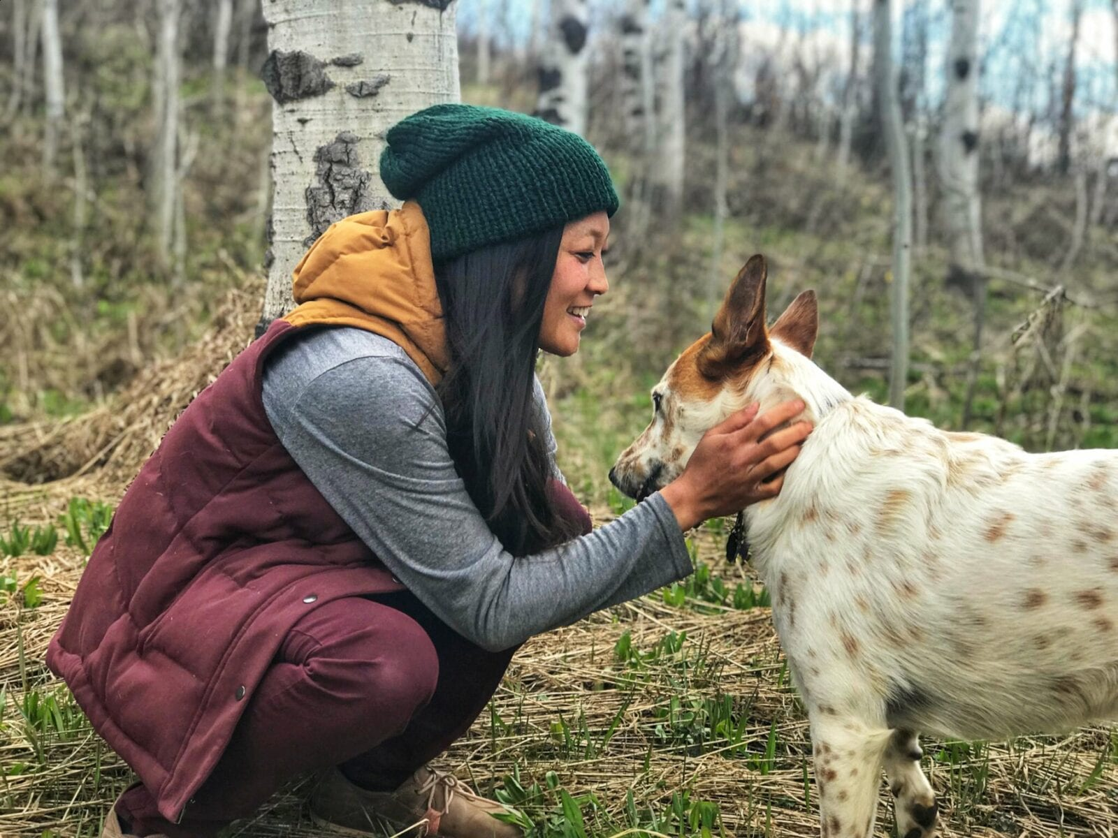 Image of the owner of Smeeny Beanie Knits, Chereen, and her dog