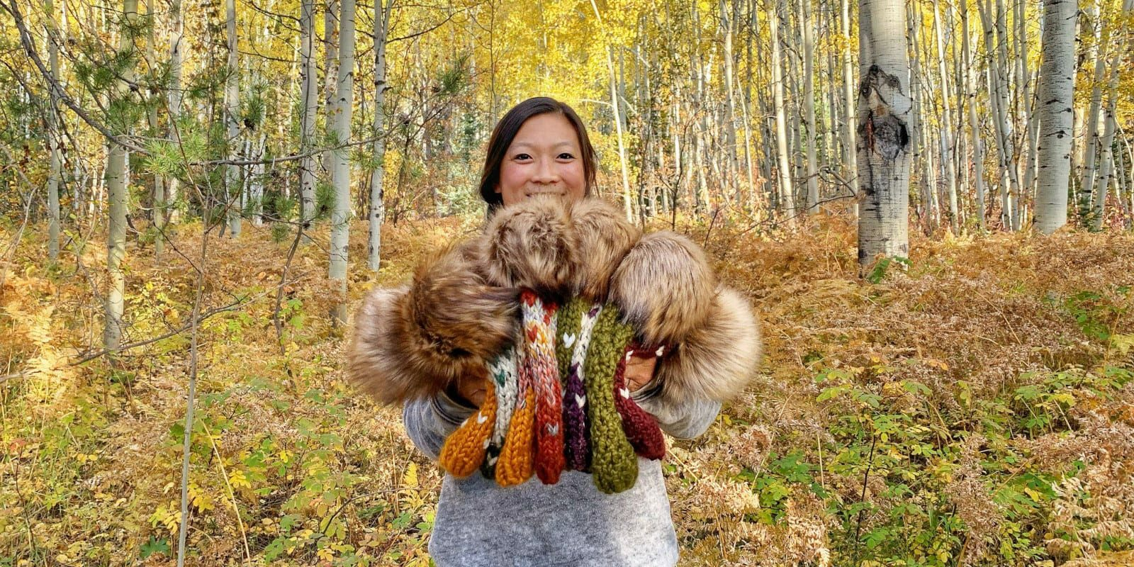 Image of Chereen, the owner, holding the beanies she knit