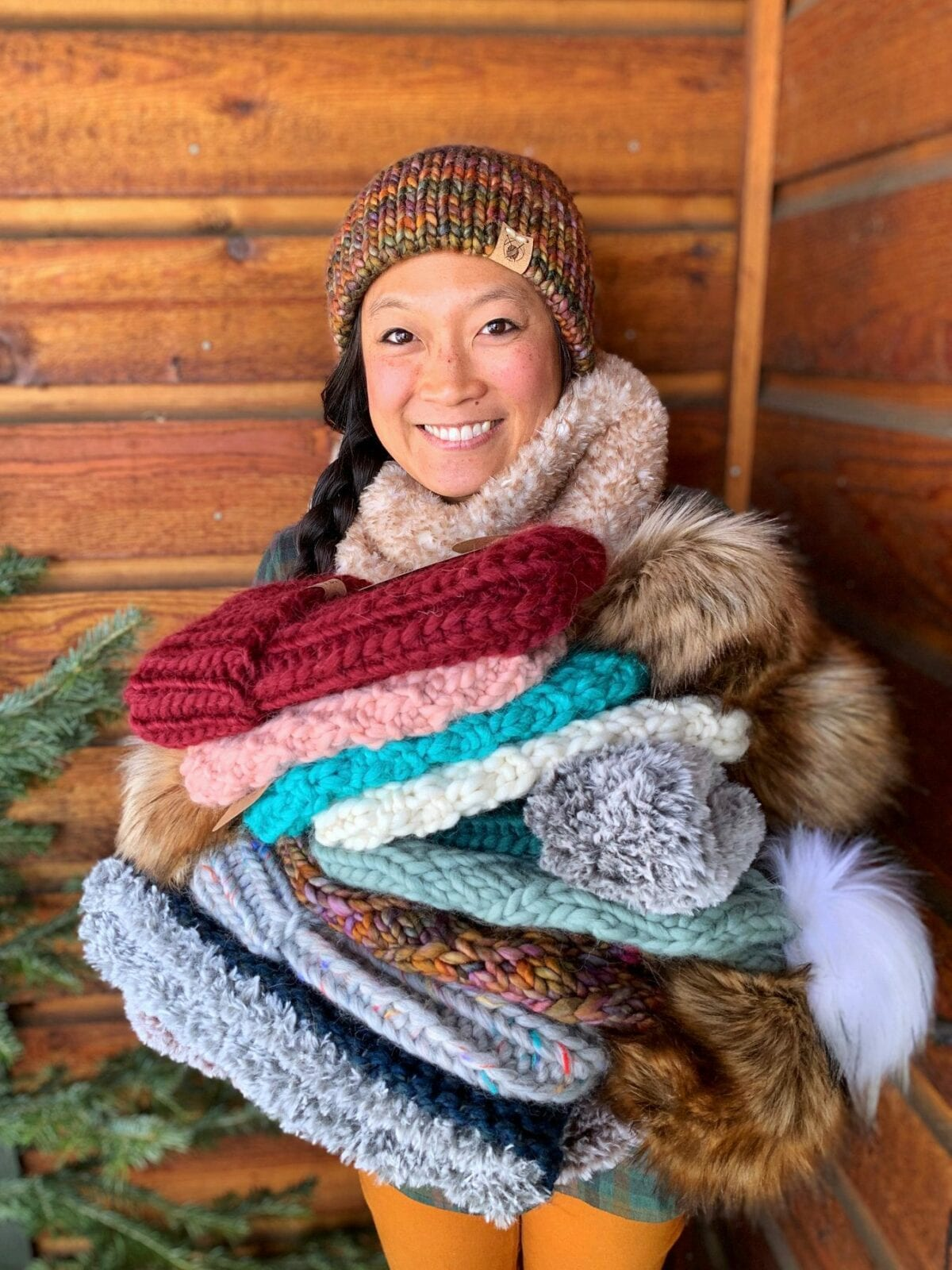 Image of Chereen, the owner, showing off her Smeeny Beanie Knit hats