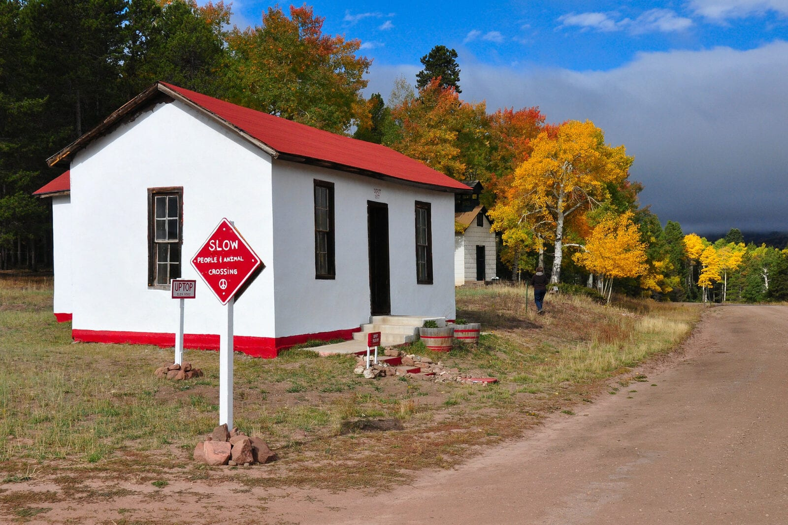 Image of a white building with red roof in autumn at Uptop ghost town in Colorado
