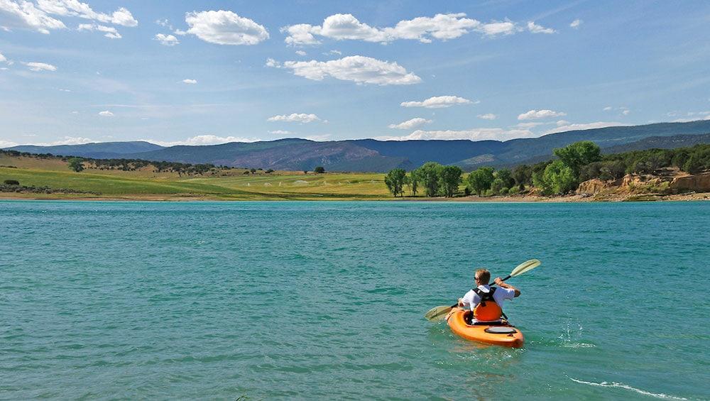 image of kayaker at harvey gap state park