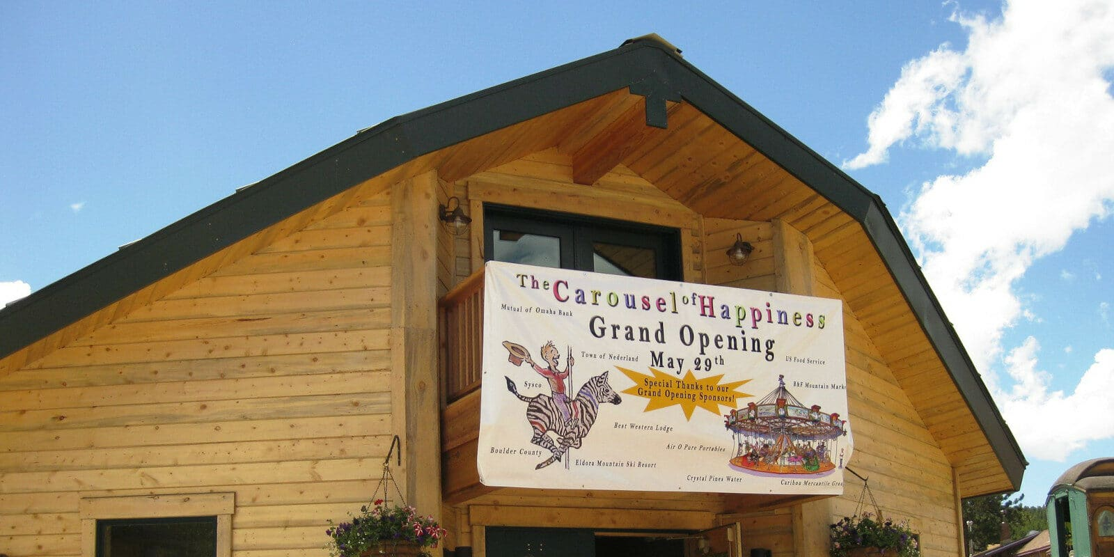 Image of the entrance sign for the Carousel of Happiness in Nederland, Colorado