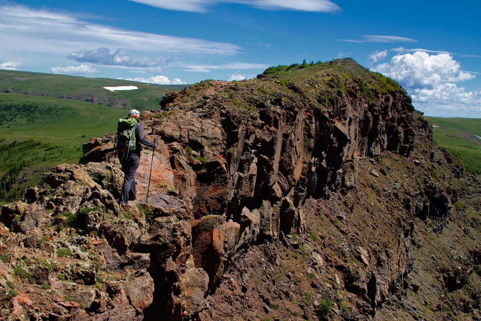 Hiker on Devil's Causeway Flat Tops Wilderness Colorado