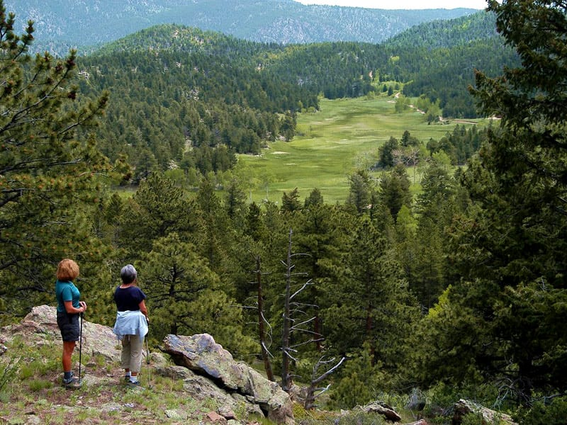 Image of two hikers at Hermit Park Open Space in Estes Park, Colorado