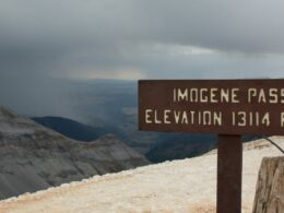 Image of the Imogene Pass elevation sign in Colorado