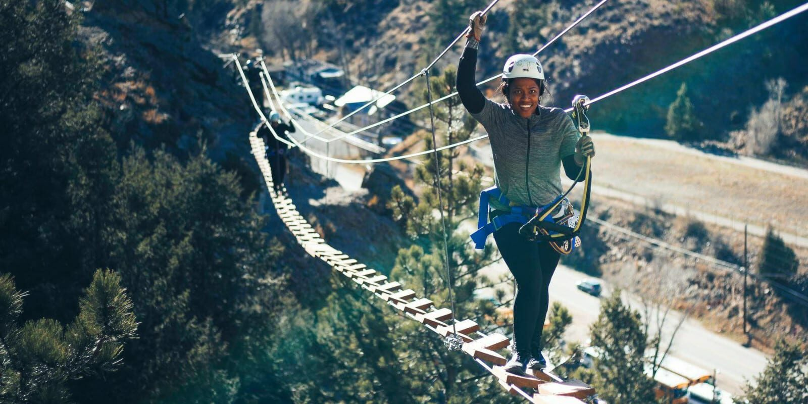 Image of a woman on a bridge on the Mount Evans Via Ferrata in Idaho Springs, Colorado