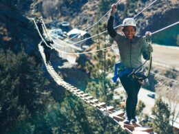 Image of a woman on a bridge on the Mount Evans Via Ferrata in Idaho Springs, Colorado