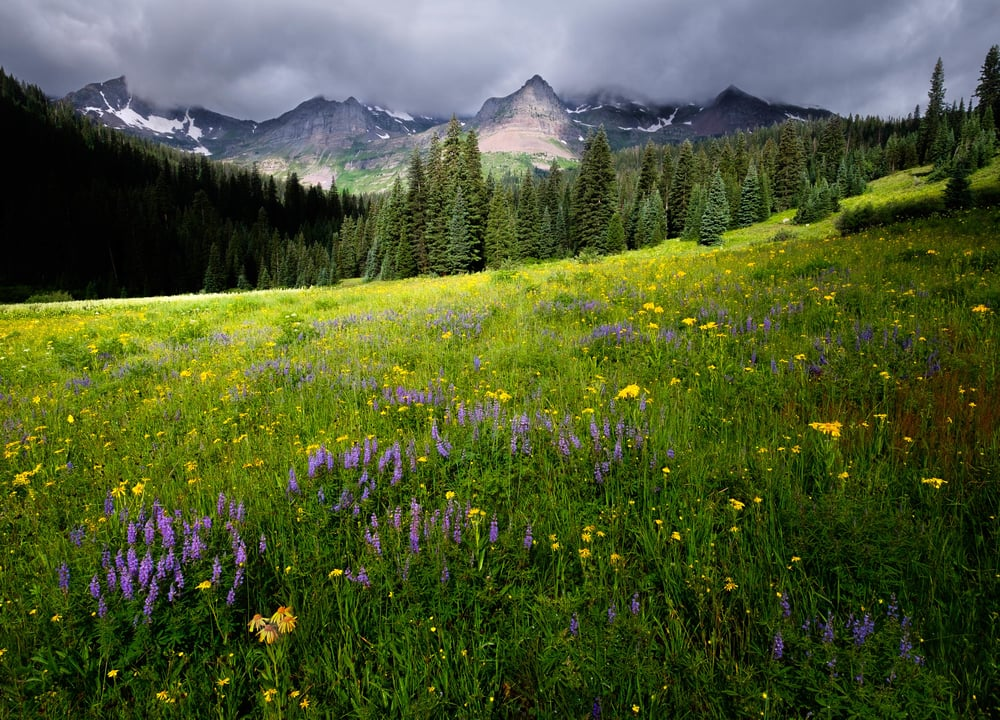Image of dark clouds over the mountains at Oh Be Joyful Recreation Area and Campground in Crested Butte, Colorado
