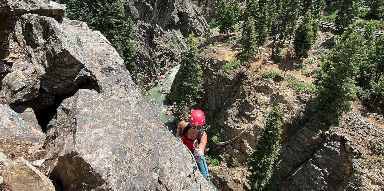 Image of a woman climbing the Ouray Via Ferrata in Colorado