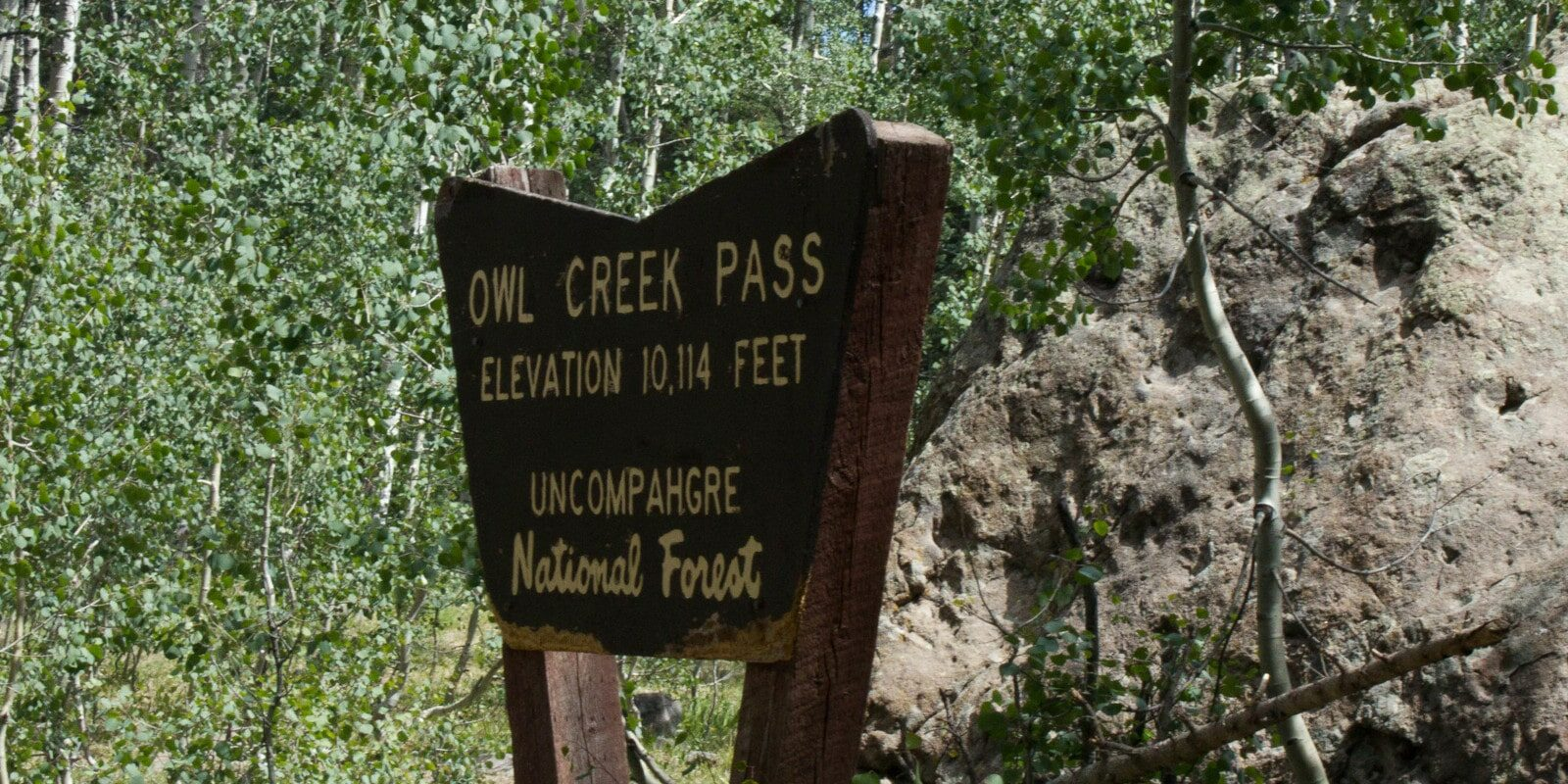 Image of the sign at Owl Creek Pass in Ridgway, Colorado