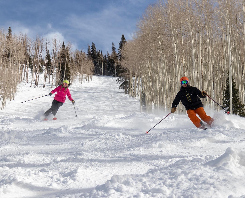 image of skiers at powderhorn resort