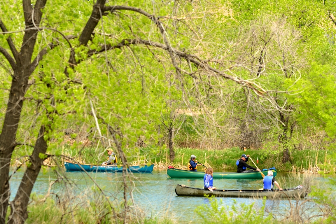 Image of people on canoes at at Riverbend Ponds Natural Area in Fort Collins, Colorado