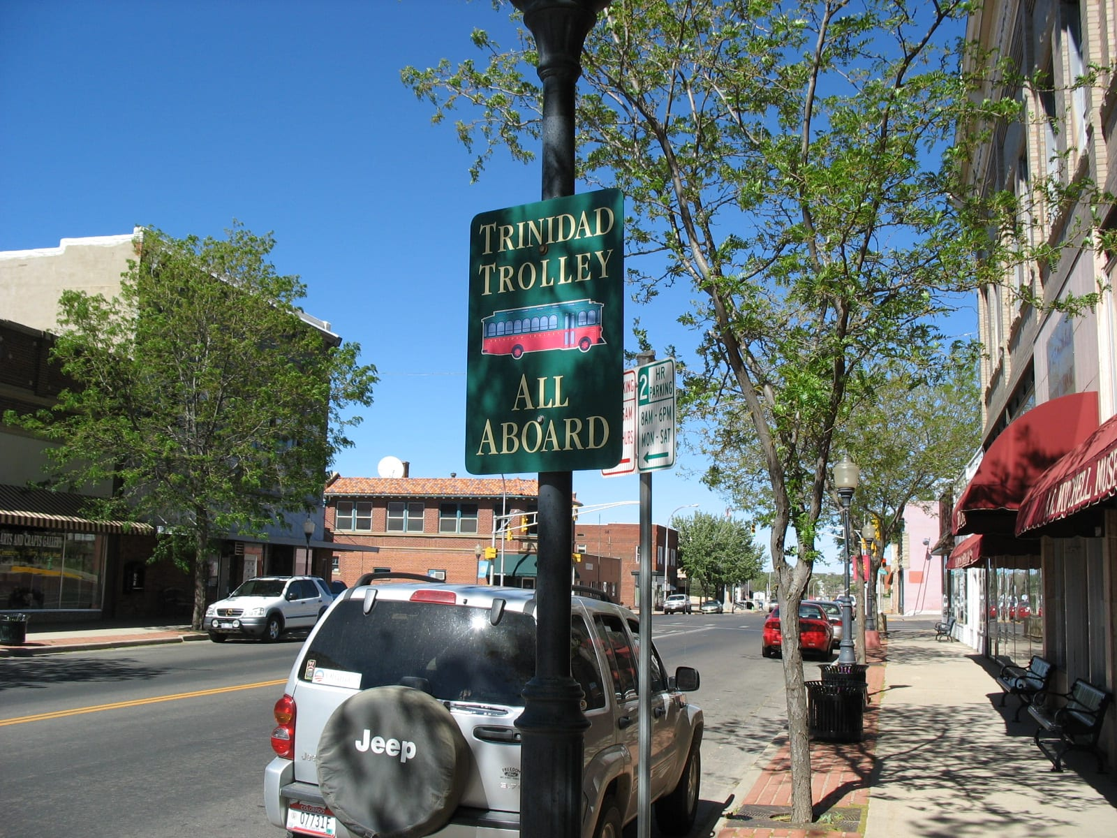 """Image of the Trinidad Trolley sign saying """"All Aboard"""" in Colorado"""