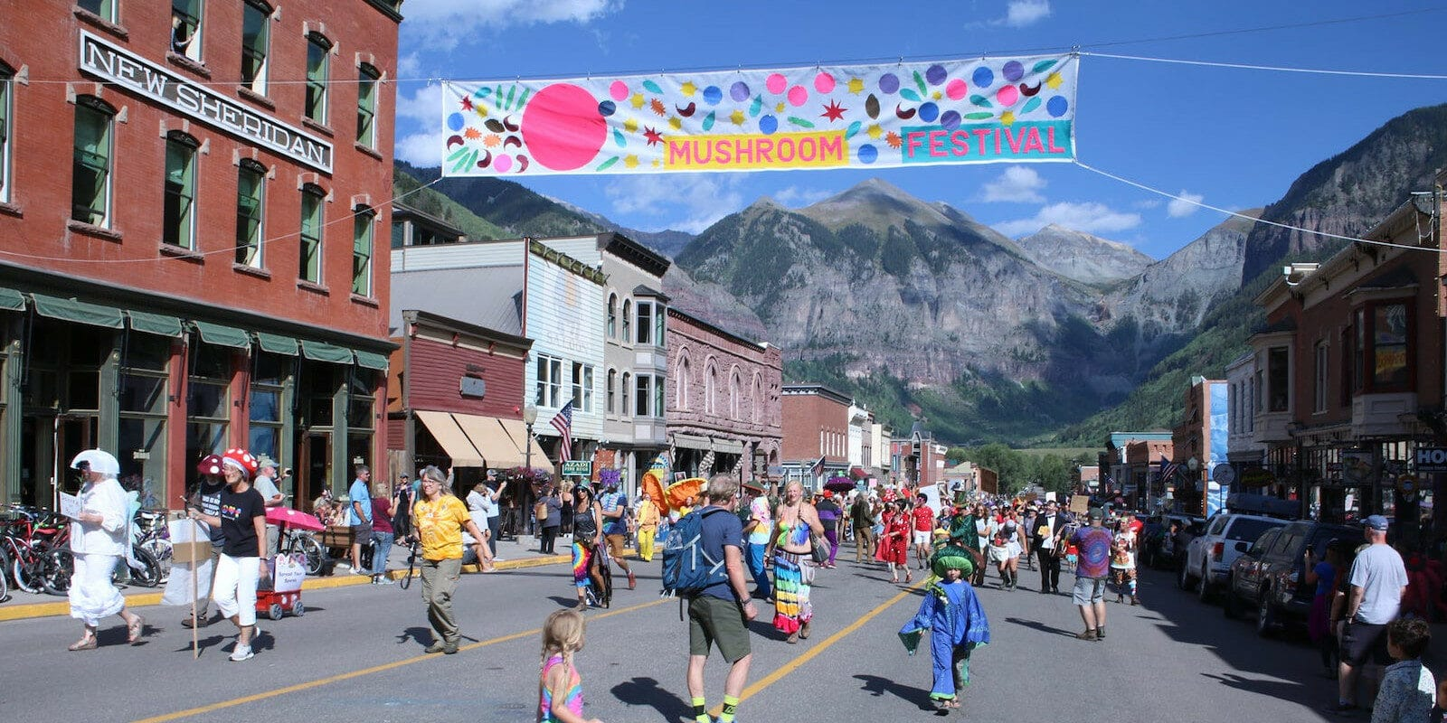 Image of the banner and festival-goers at the Telluride Mushroom Festival in Colorado