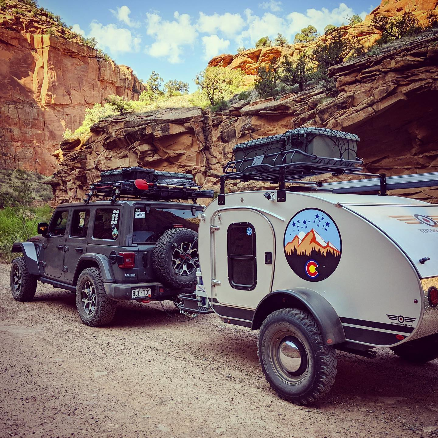 Image of a Vintage Overland trailer being towed by a jeep