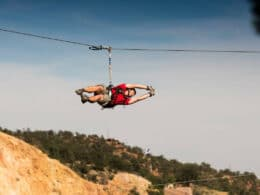 Image of a person on a zipline with Adventures Out West