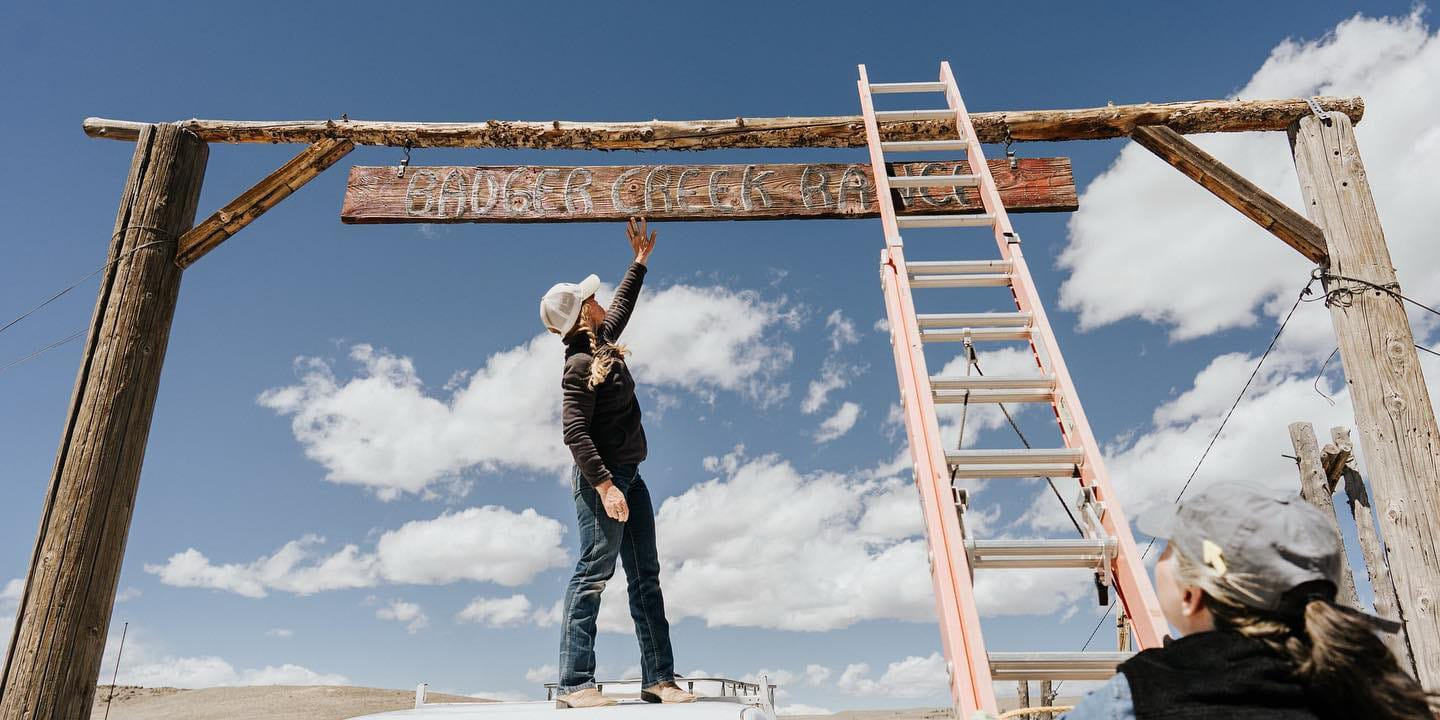 Image of the Badger Creek Ranch sign being painted