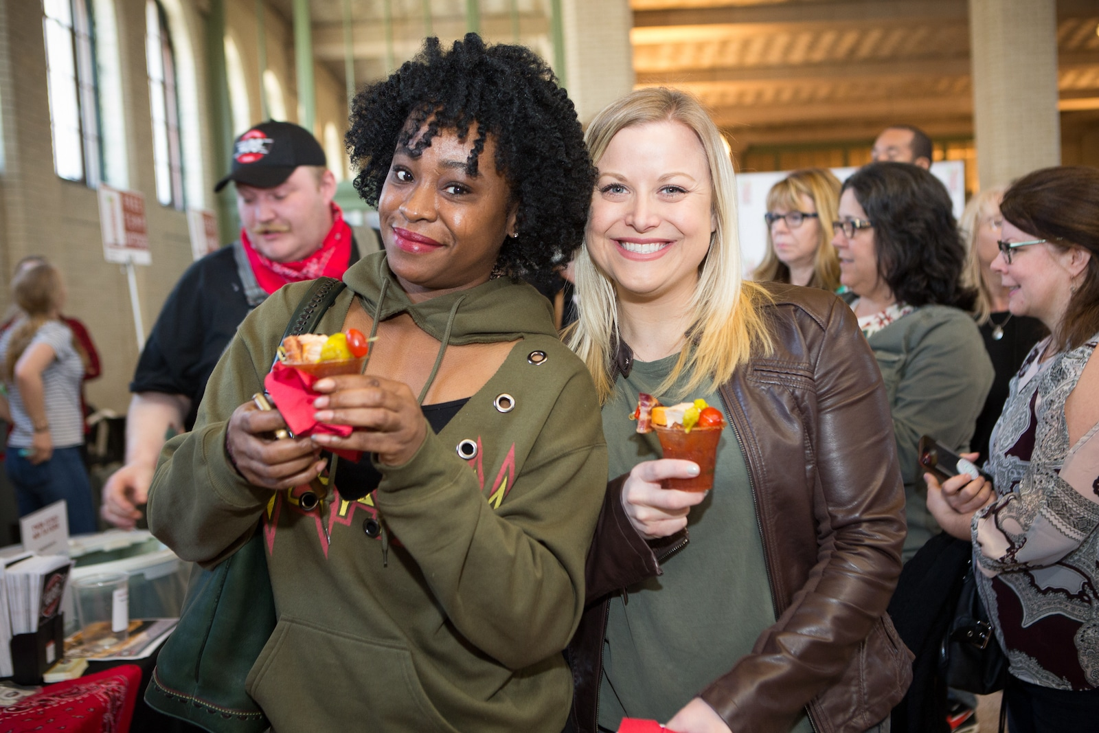 Image of two women enjoying bloody marys at the bloody mary festival