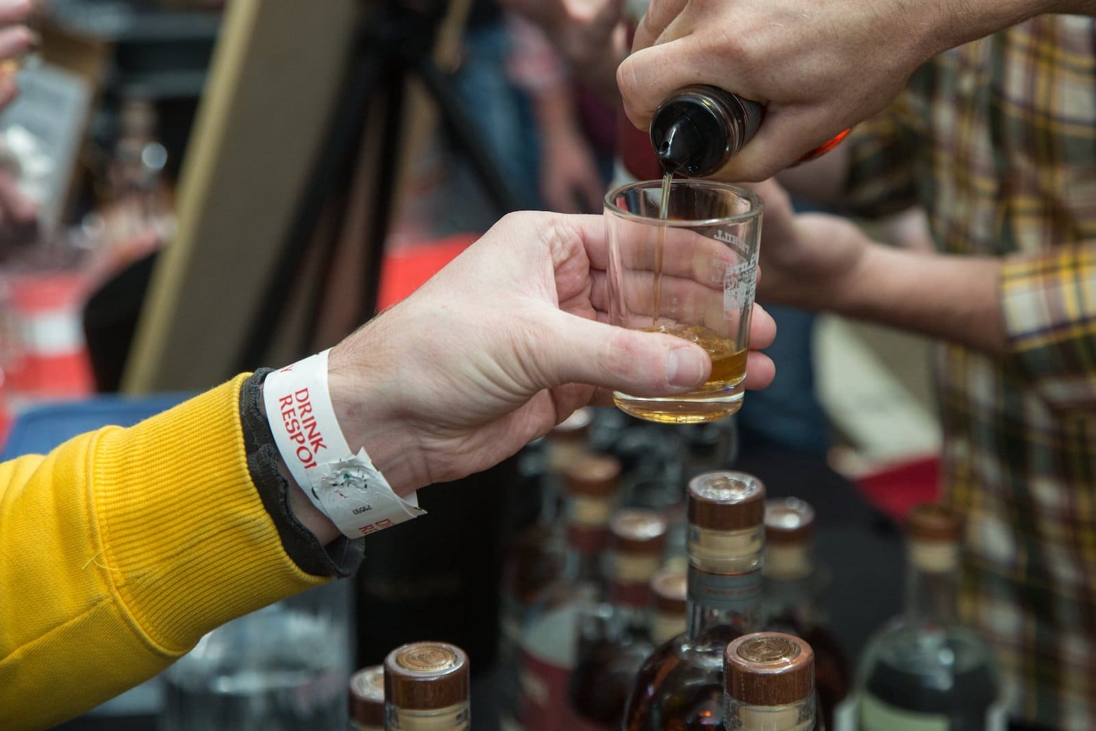 Image of a person pouring a sample at the Breckenridge Craft Spirits Festival in Colorado