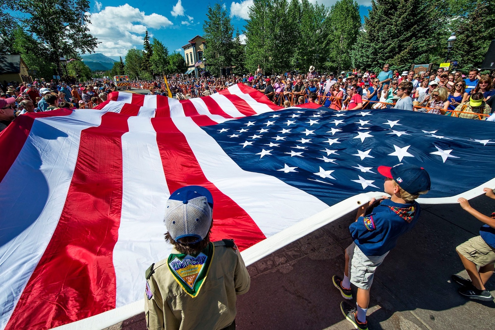 Image of kids holding the American flag for Independence Day in Breckenridge, Colorado