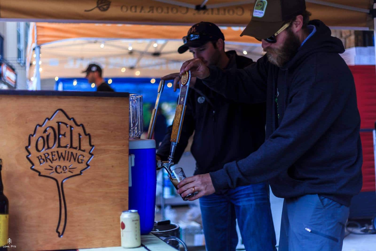 Image of guys at the Odell Brewing Co booth at Breckenridge Strings, Beers, and Ciders festival in colorado