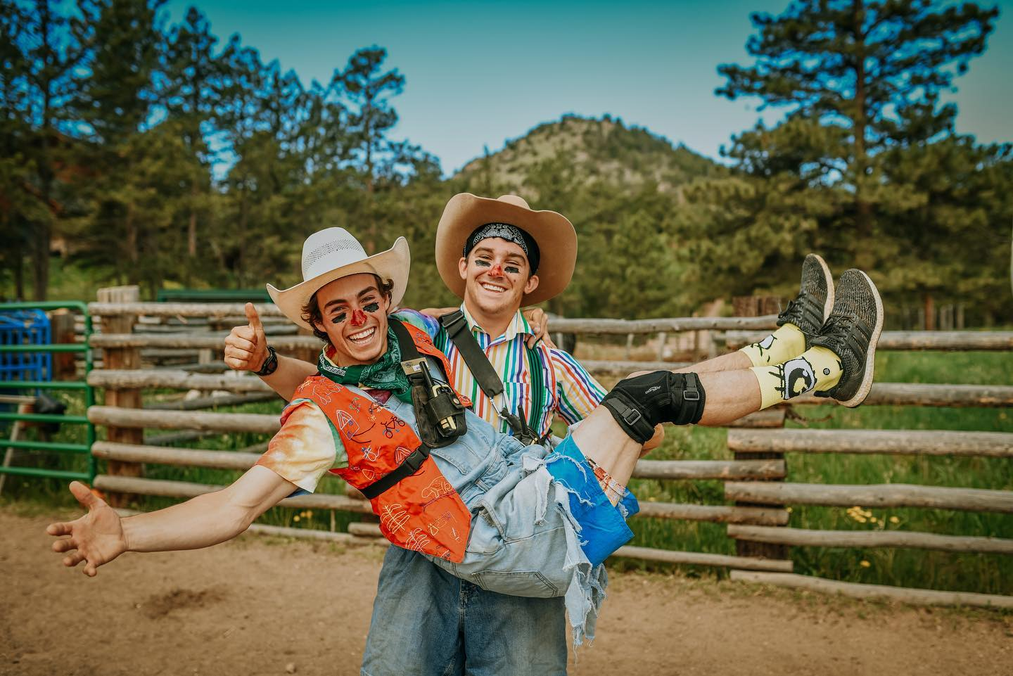 Image of two ranch hands clowning around at Cherokee Park Ranch in Livermore, Colorado