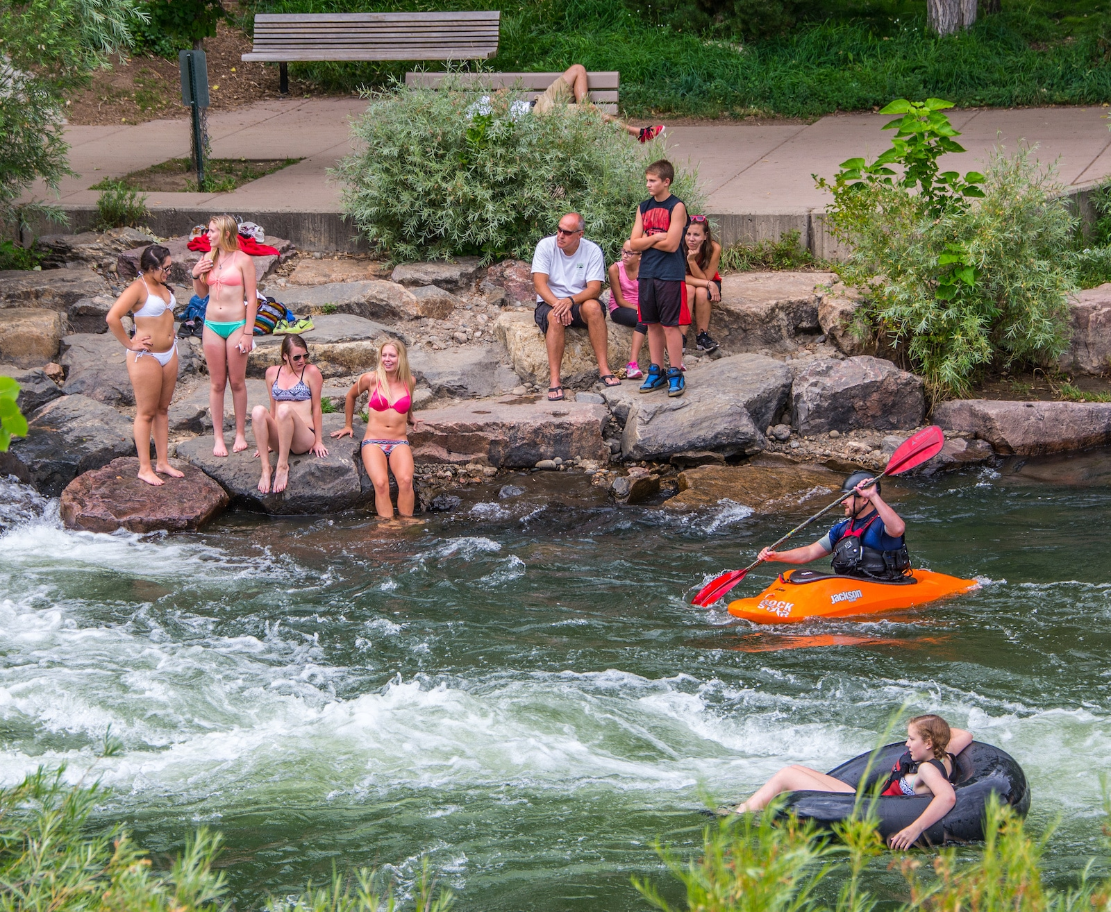 Tuber and Kayaker on Clear Creek in Golden CO Summer