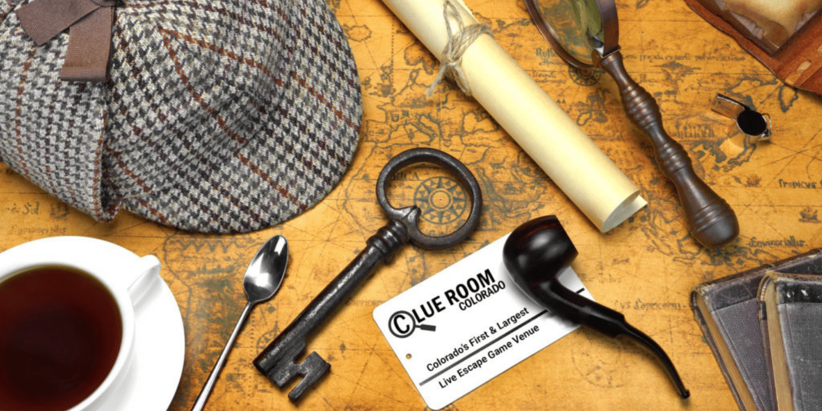 Image of a detective hat, pipe, magnifying glass, and key
