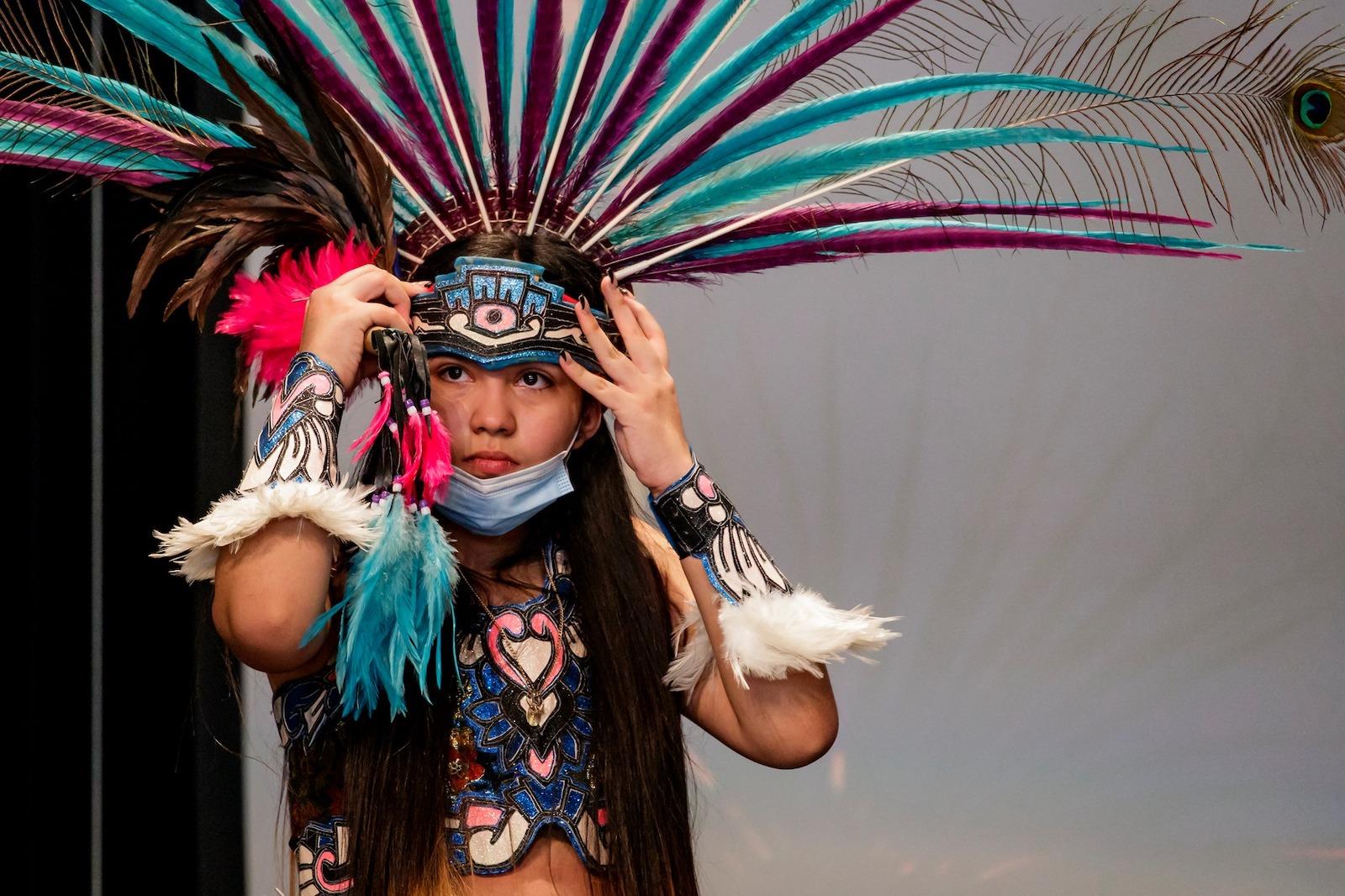 Image of a aztec dance performer at Brecknridge's Dia De Los Muetros festivities in Colorado