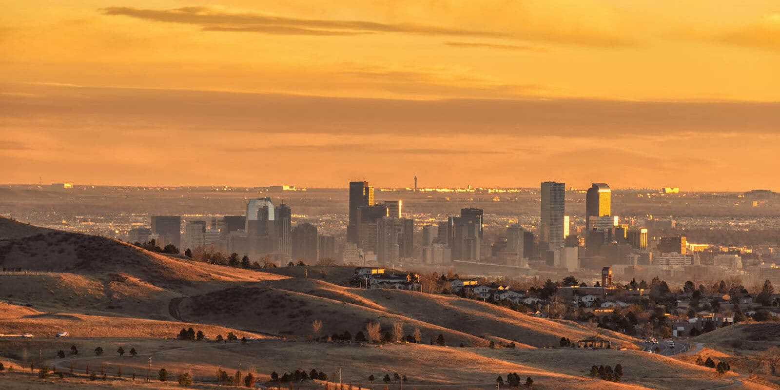 Downtown Denver and Airport Sunrise from Red Rocks