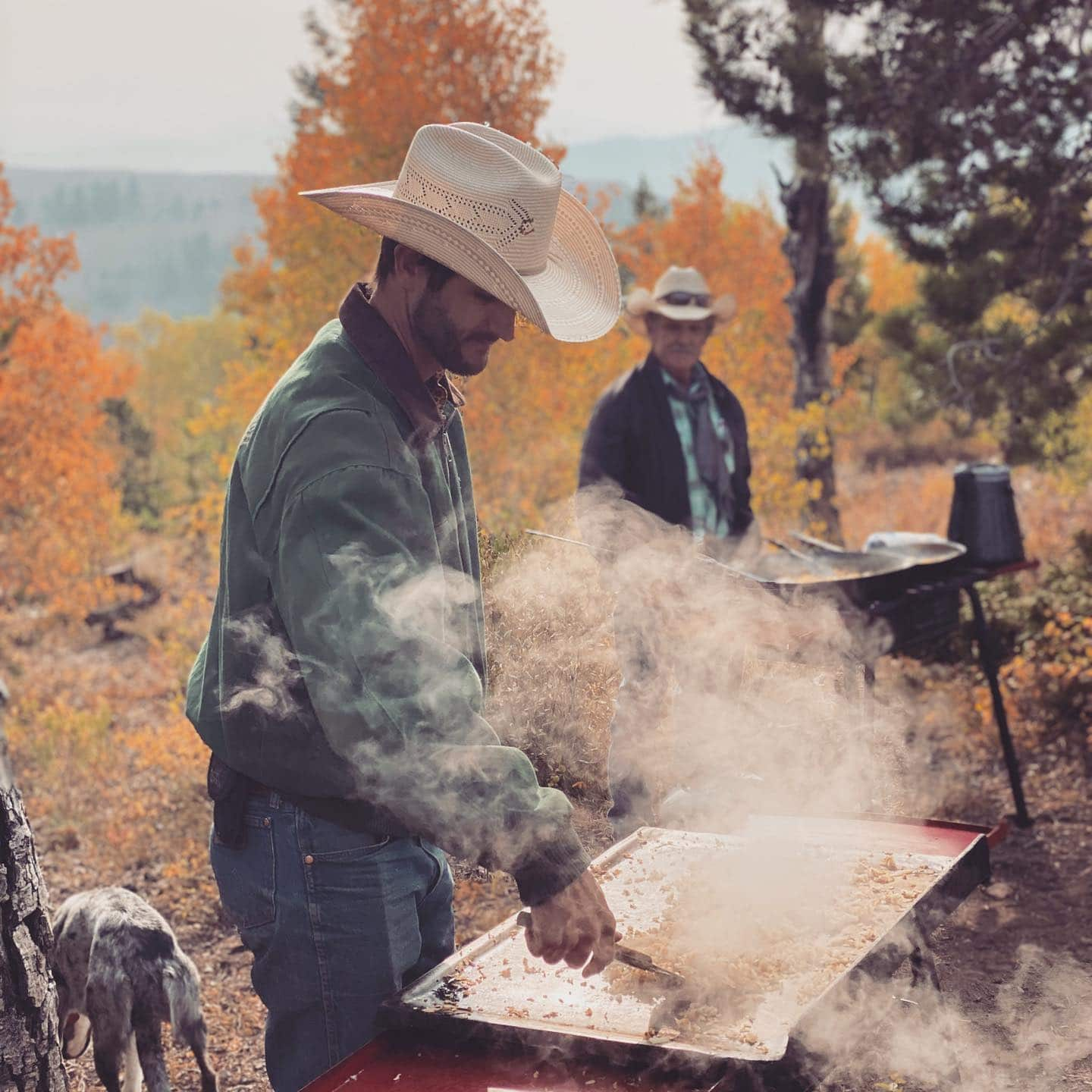 Image of a cowboy at the Drowsy Water Dude Ranch making dinner