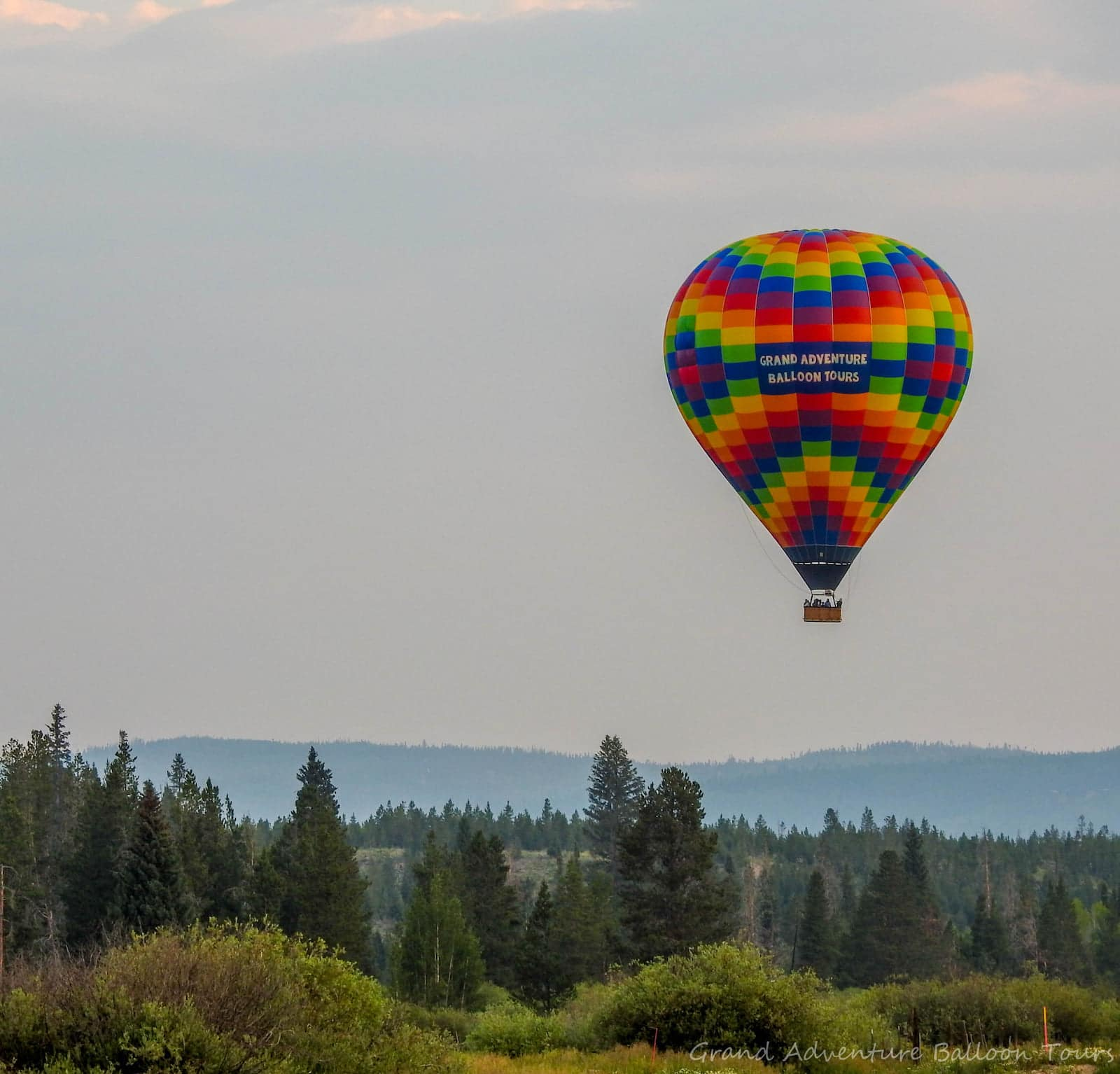 Image of a Grand Adventure Balloon Tours hot air balloon in Fraser, CO