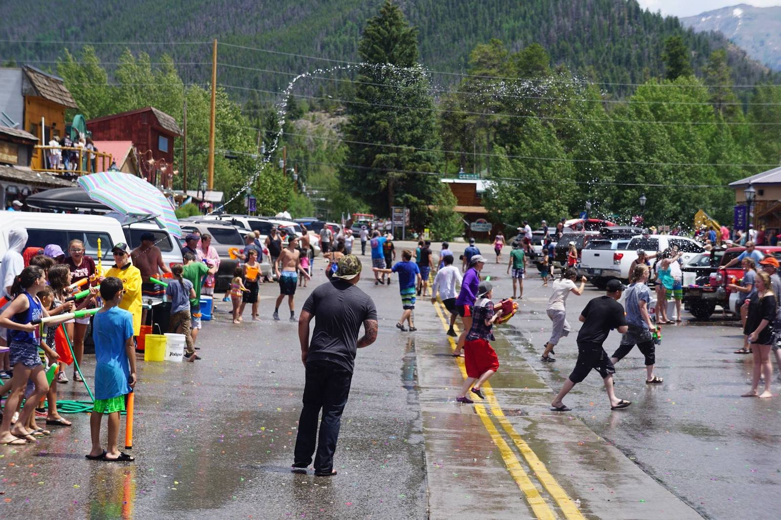 Image of people having a water balloon fight at Grand Lake's Buffalo Days in Colorado