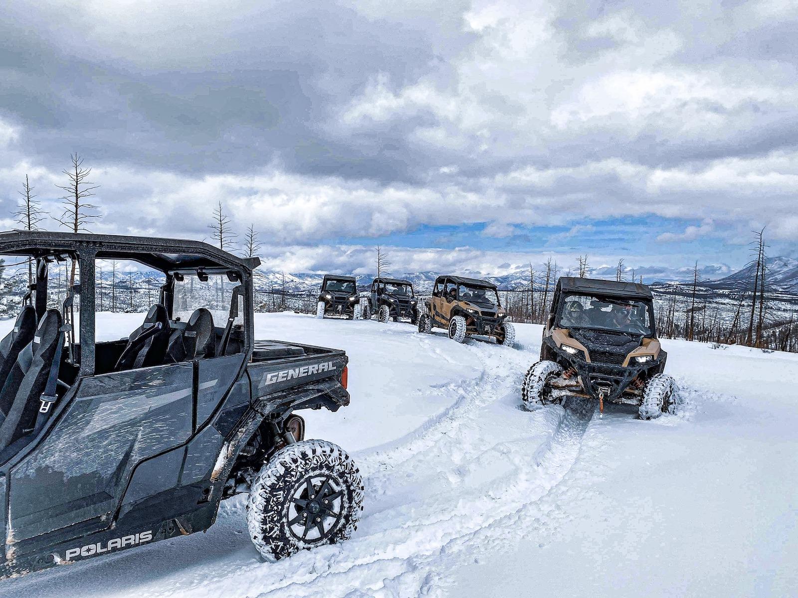 Image of snowy UTVs driving in colorado