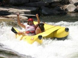 Gunnison River Festival Rafter on Banana Boat in Whitewater Park