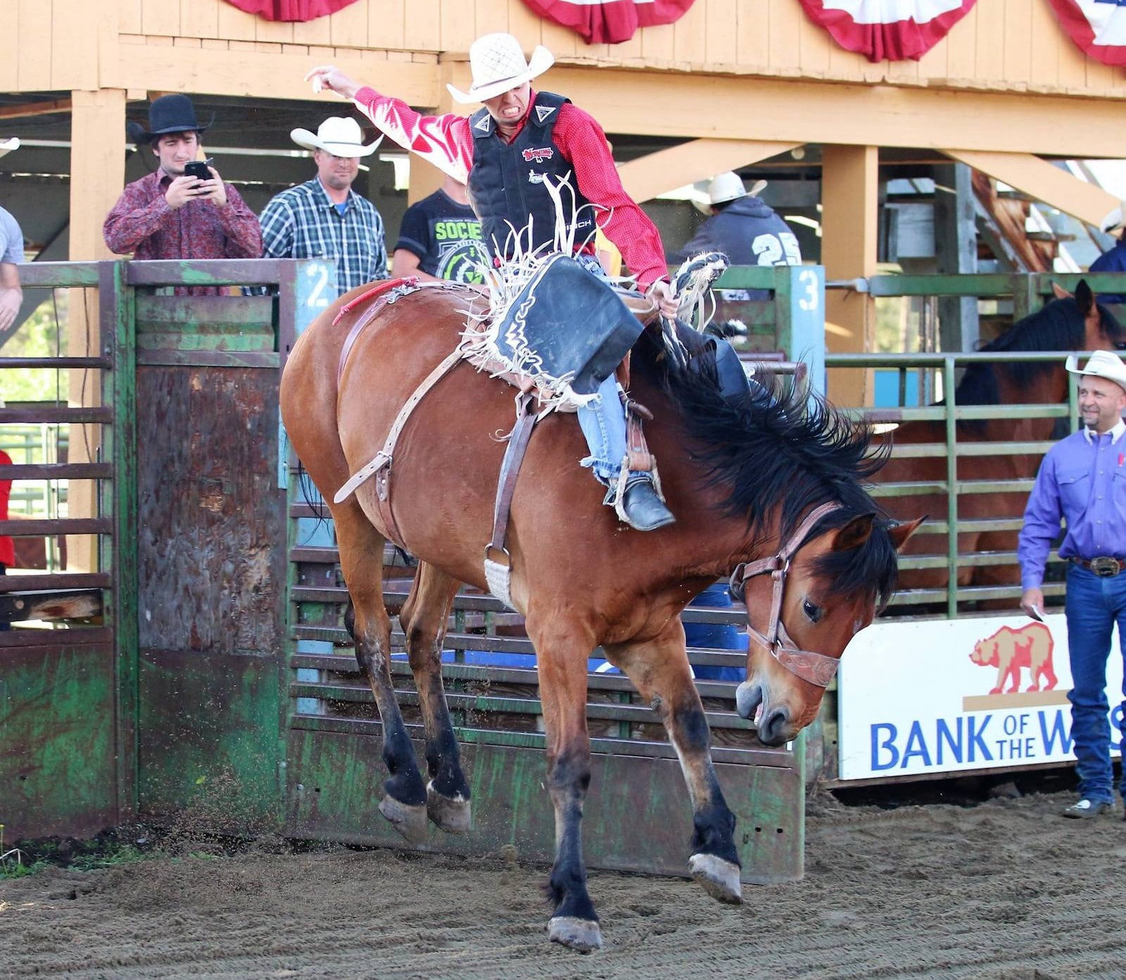 Image of a man riding a bucking horse at High Country Stampede Rodeo in Fraser, Colorado