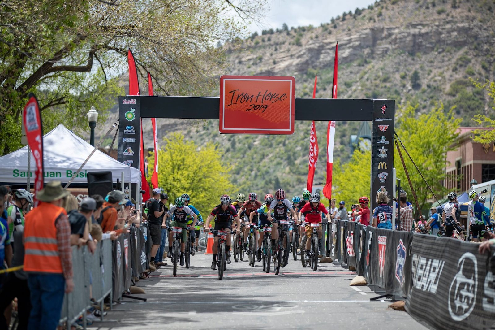 Image of bikers crossing the line at the 2019 Iron Horse in Durango