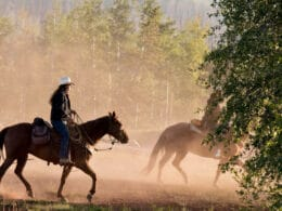 Image of people riding horses at Latigo Ranch in Kremmling, CO