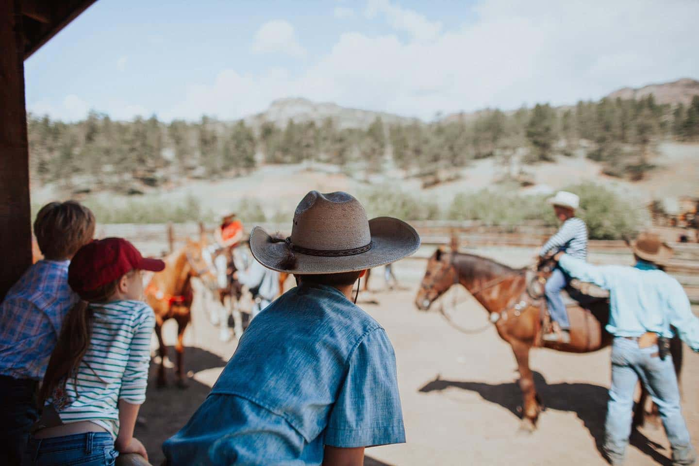 Image of kids watching people riding horses at Lost Valley Ranch in Sedalia, Colorado