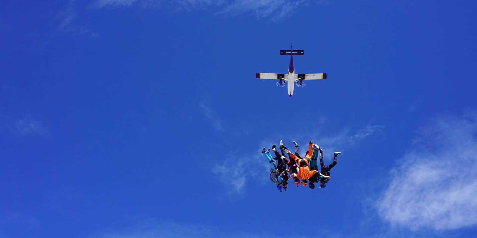 Image of skydivers falling to earth from a plane at Mile-Hi Skydiving Center in Longmont, CO