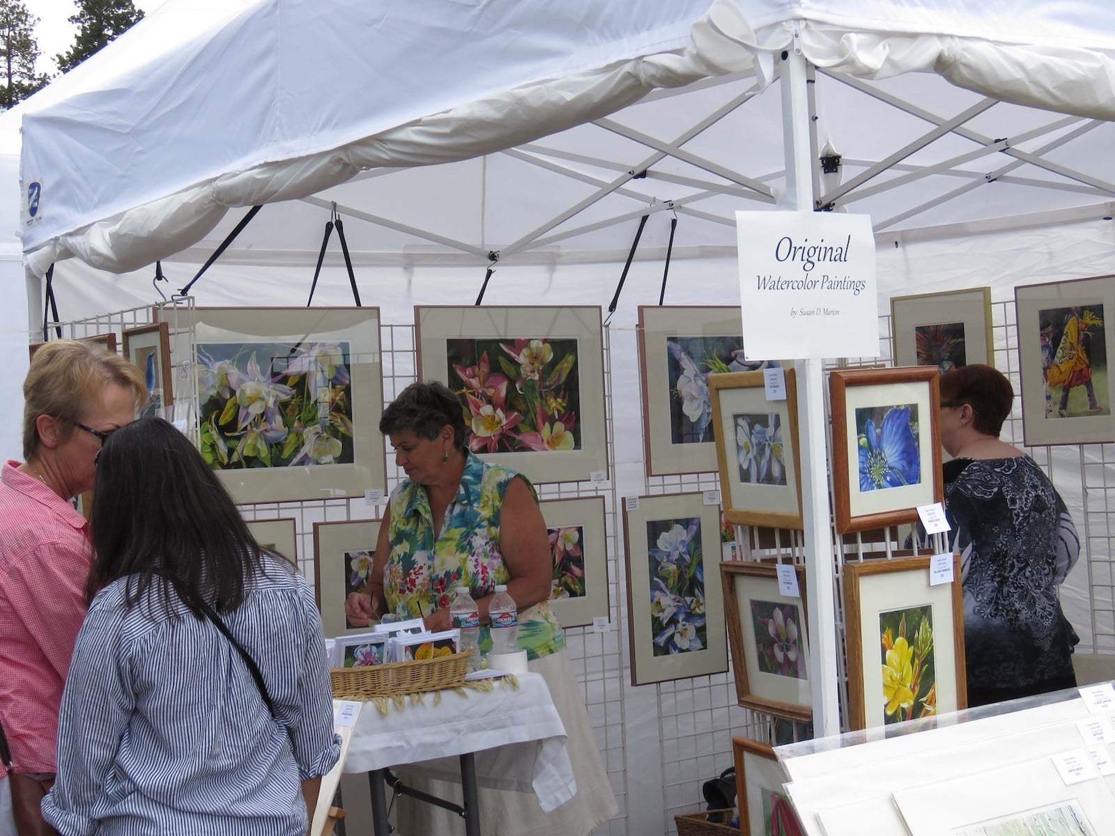Image of a watercolor painting stall at the Mountain Arts Festival in Woodland Park, Colorado