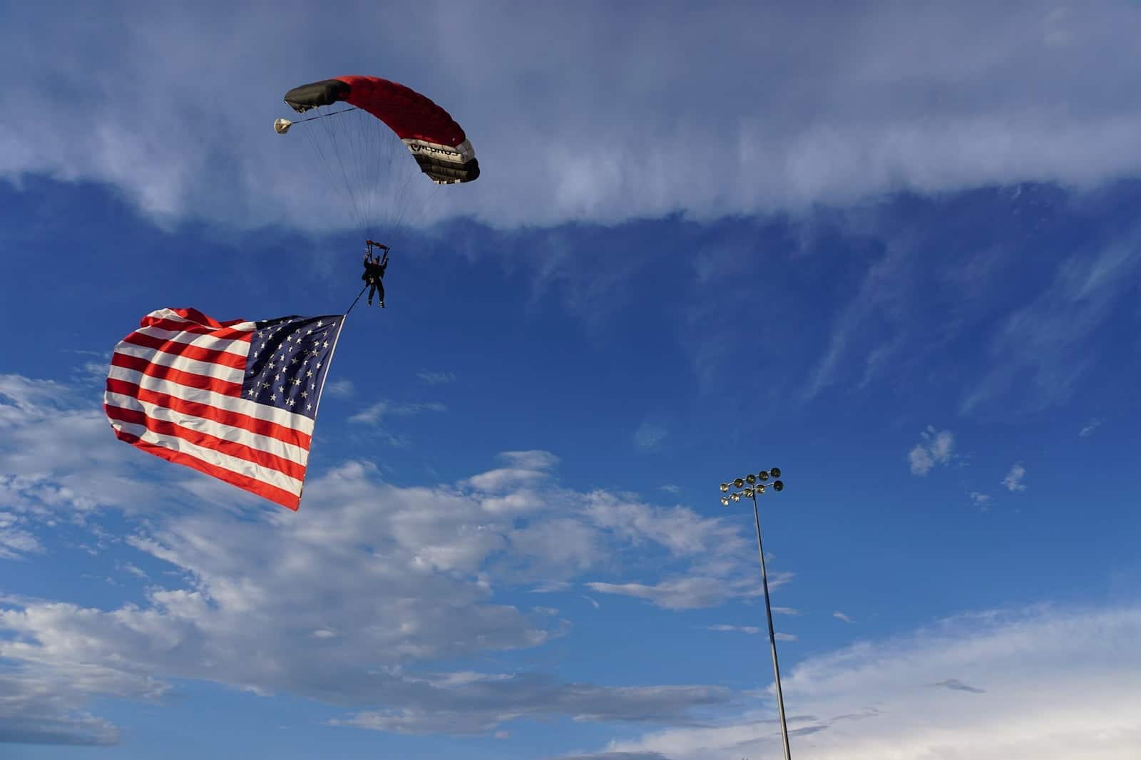 Image of a skydiver from Out of the Blue Skydiving with the USA flag in Calhan, CO