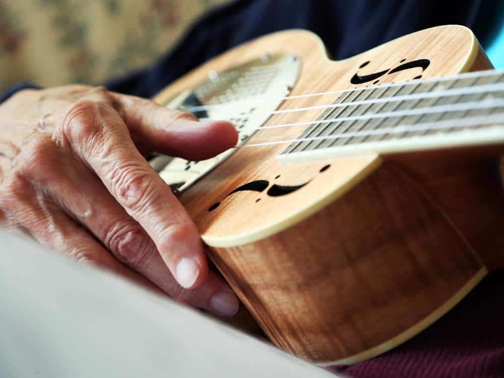 Image of a person playing a ukulele