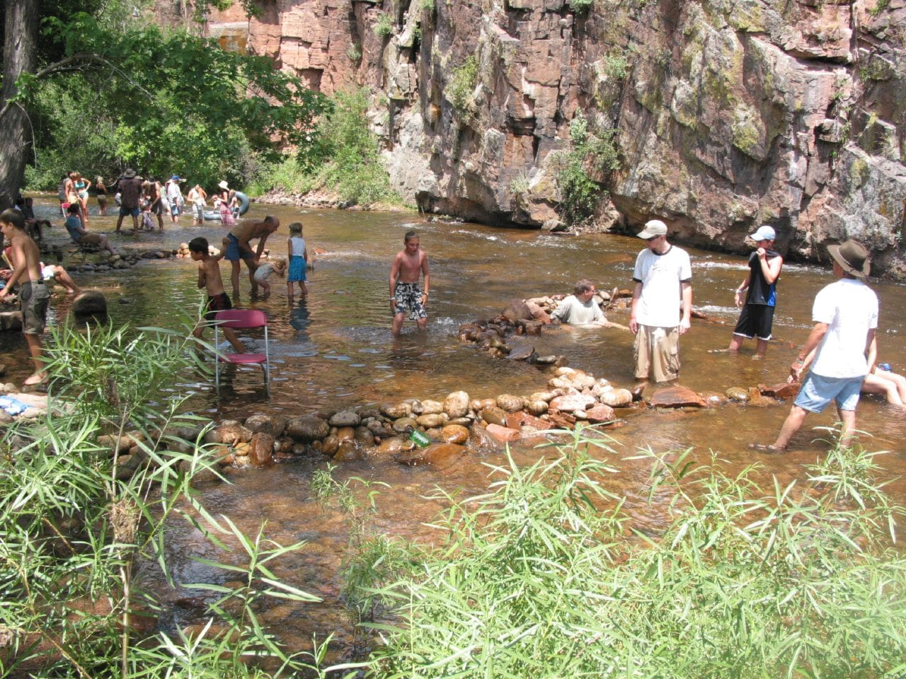 Image of a dam created by festival-goers at Rockygrass Festival in Lyons, CO