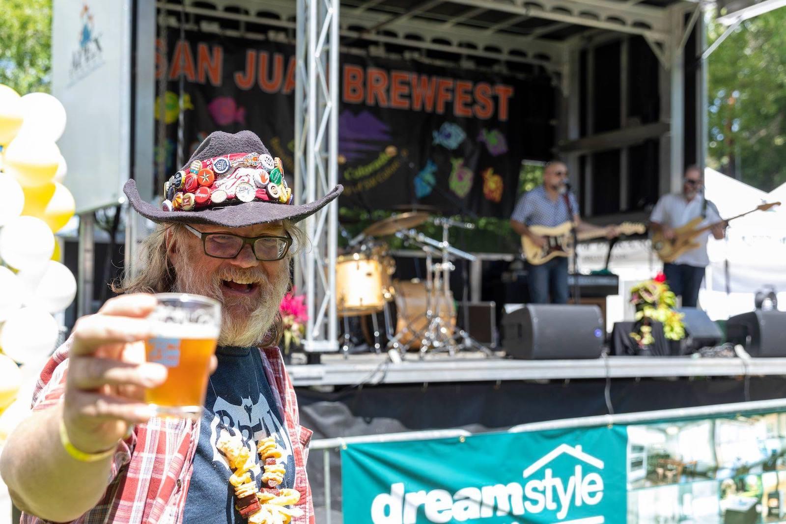Image of a man enjoying a beer at the San Juan Brewfest in Durango, Colorado