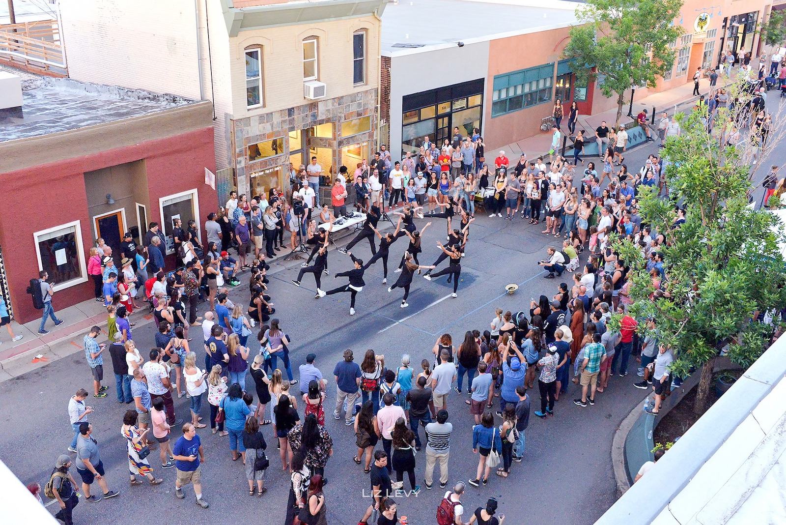 Image of people watching a dance performance at the Art District on Santa Fe in Denver, Colorado